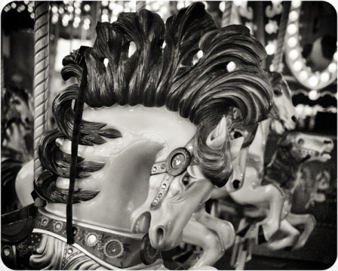 Black and white photo of a wooden horse on a Merry-Go-Round. OC Fair, Costa Mesa, California. August 9th, 2012. | Copyright © 2012. stFOTOgrafer. All Rights Reserved!
